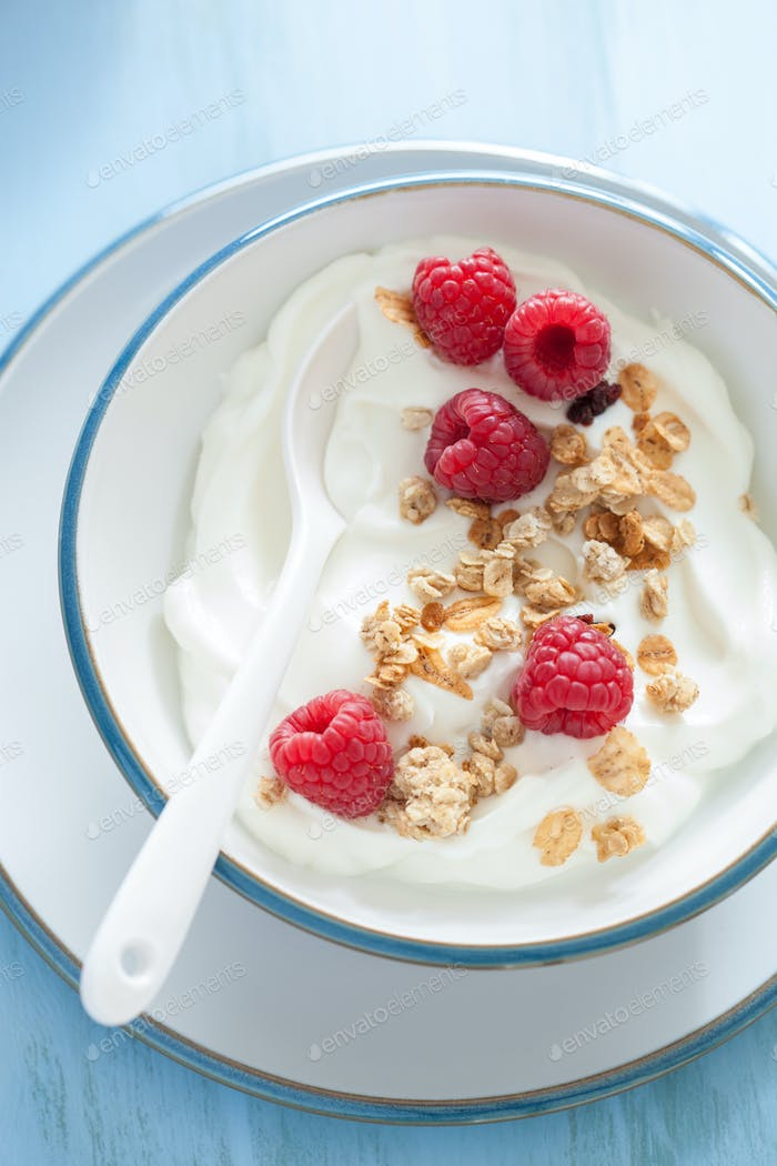 yogurt with granola and raspberry for healthy breakfast