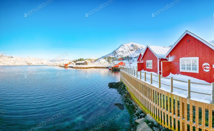 Traditional Norwegian red wooden houses on the shore of  Sundstraumen strait
