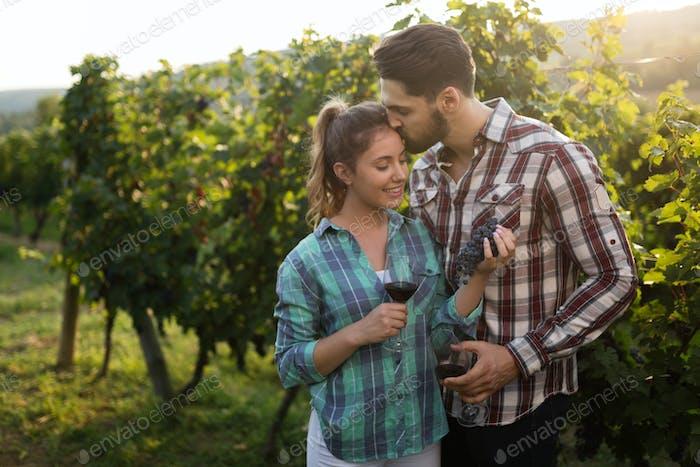 Couple in love working at winemaker vineyard