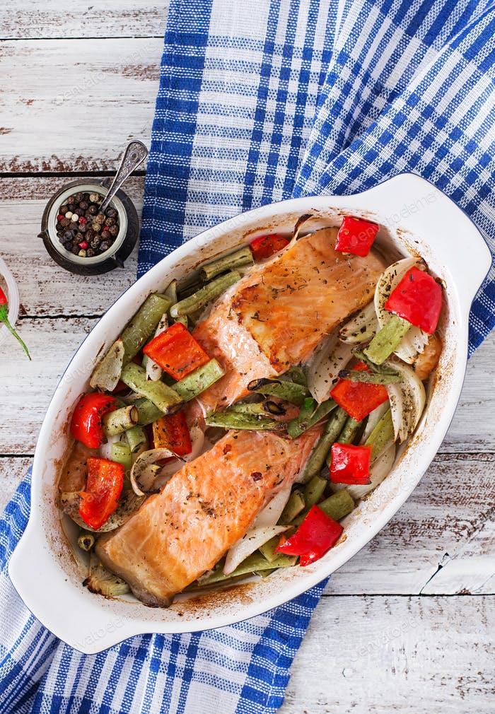 Baked salmon fillet with vegetables and herbs.