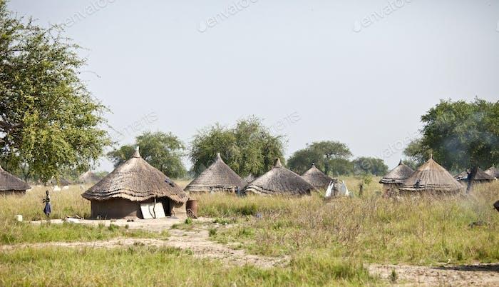 Village of grass huts in remote area of South Sudan.