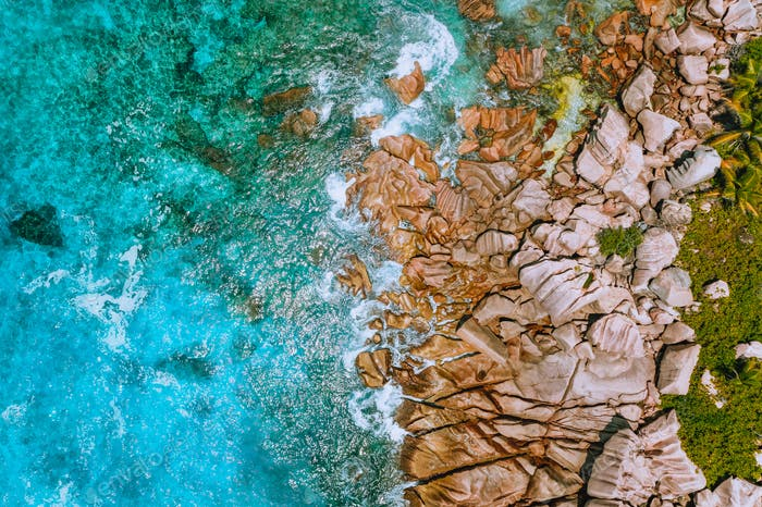Aerial view of Seychelles Anse Cocos beach at La Digue Island. Pure crystal clear turquoise ocean