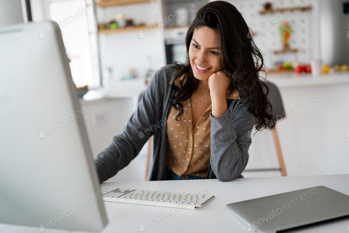 Attractive business woman working on computer. Business technology people concept