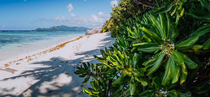 Anse Source d'Argent Paradise beach in the morning with view to Praslin Island on horizon, La
