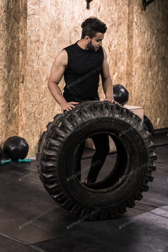 Sport Fitness Man Flipping Wheel Tire Crossfit Training