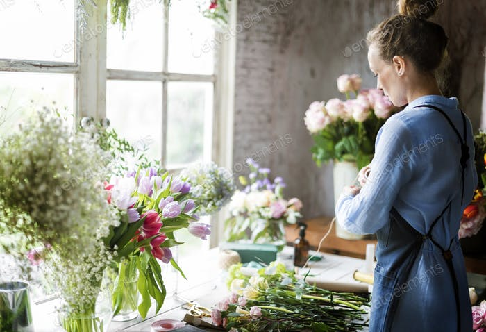 Florist Making Fresh Flowers Bouquet Arrangement