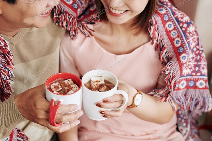 Couple drinking sweet cocoa