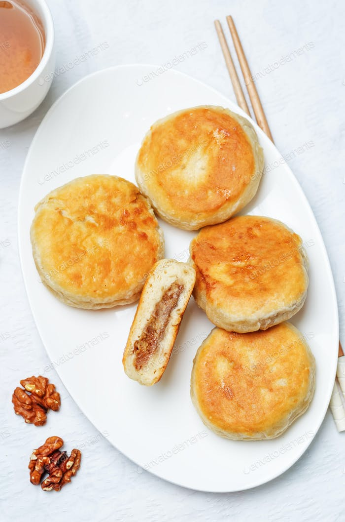 Korean sweet pancakes with nuts topping. Hotteok