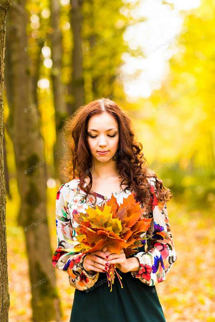 Beautiful elegant woman  in autumn