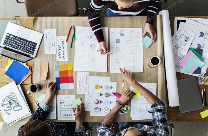 Colleagues working together at a desk