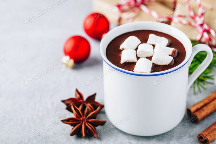 Festive Christmas Hot Chocolate with marshmallow and cinnamon stick