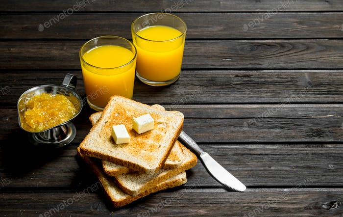 Toasted bread with butter, orange jam and juice.