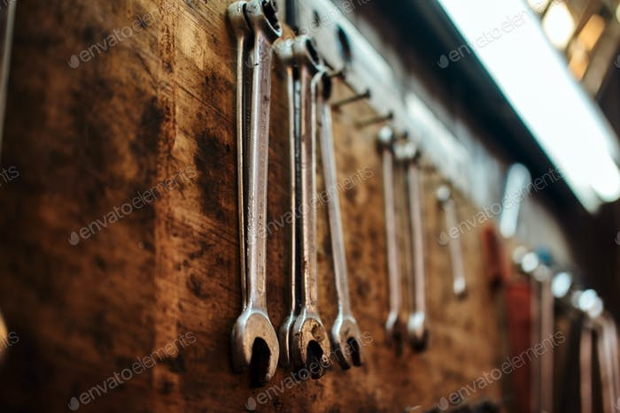 A lot of wrenches on the wall at workshop