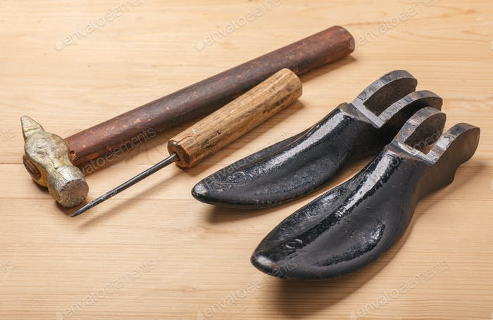 old shoemaker tools, hammer, awl