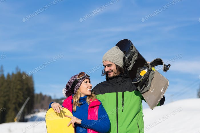 Couple With Snowboard Ski Resort Snow Winter Mountain Smiling Man And Woman Extreme Sport Vacation