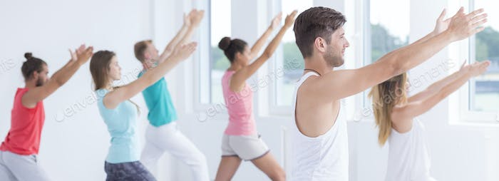 Relaxed people practicing yoga