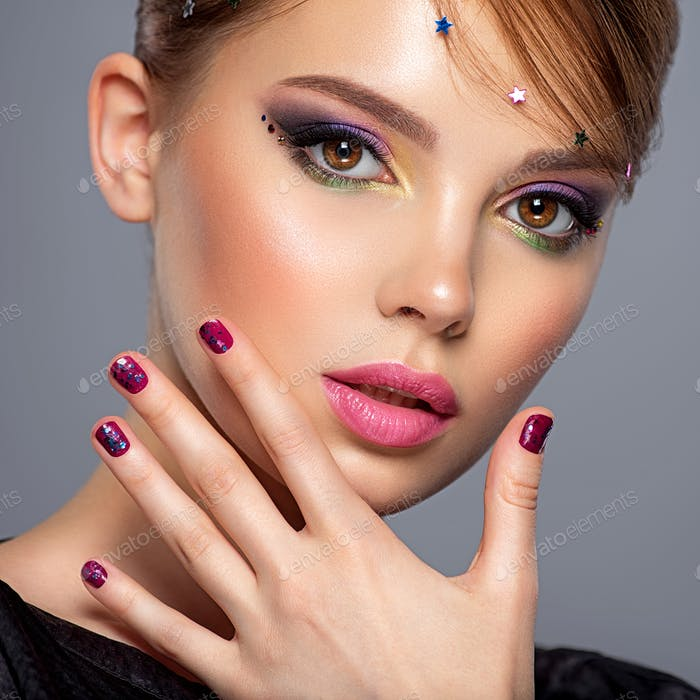 Portrait of a beautiful woman with bright makeup.