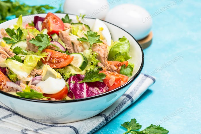 Tuna salad with green leaves, eggs and vegetables