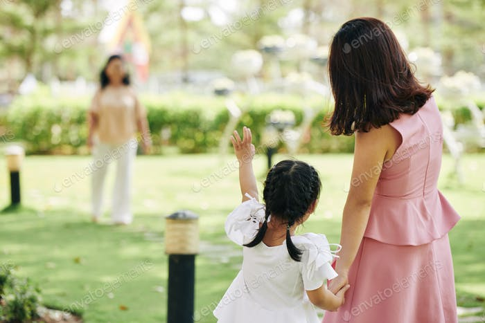 Girl waving to grandmother