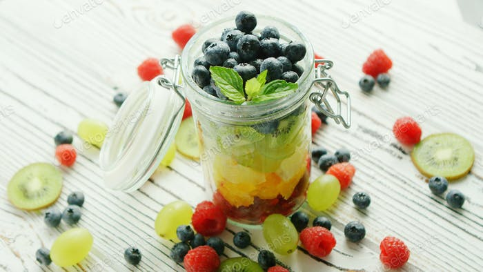 Jar filled with colorful fruit