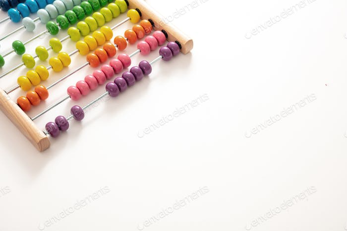 School abacus with colorful beads on white color background, close up view