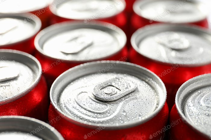 Cans with soda all over background, close up