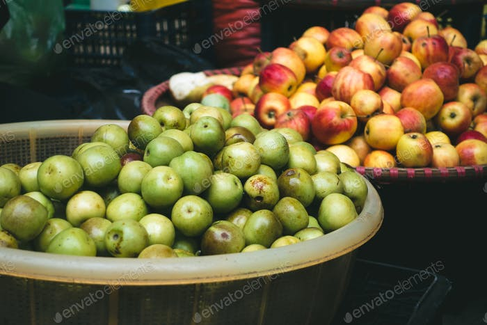 Fresh small apples at a Vietnamese farmers market