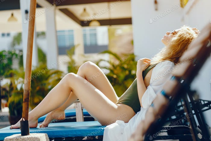 blonde girl relaxing at the pool