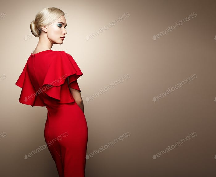 Fashion portrait of elegant woman in red dress
