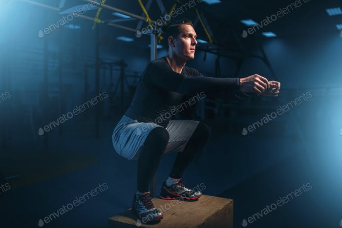 Athlete on training, endurance exercise with box