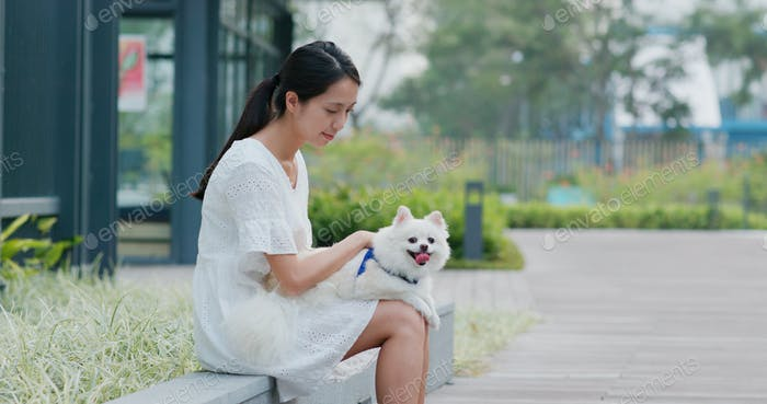 Woman go out with her Pomeranian dog