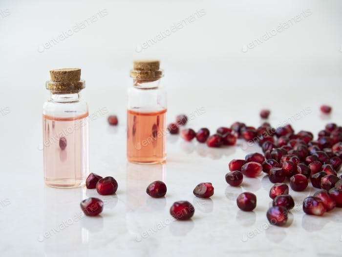 Two Bottles of Pomegranate Extract