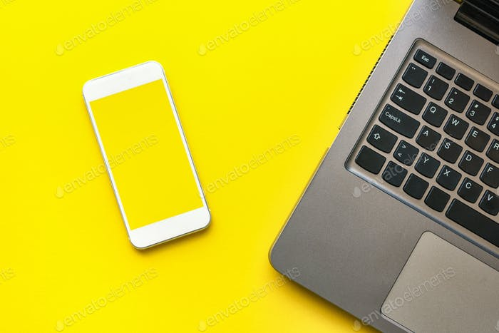 Smartphone mock up screen and laptop computer