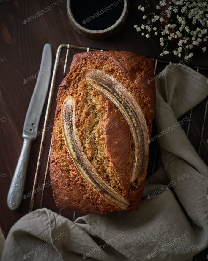 Banana bread. Cake with banana, traditional american cuisine. Whole loaf. Dark background