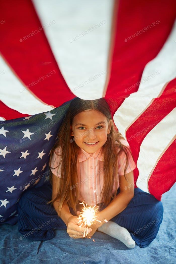 Smiling Little Girl Enjoying 4th Of July Celebration