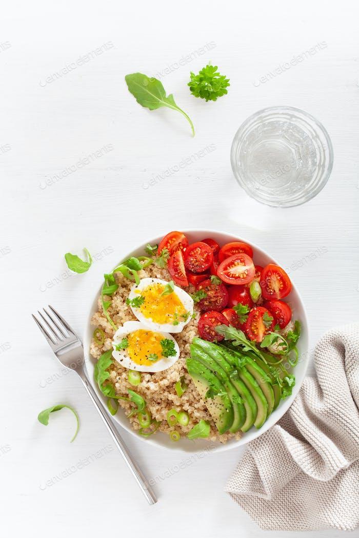 quinoa with boiled egg, avocado, tomato, arugula. healthy breakf