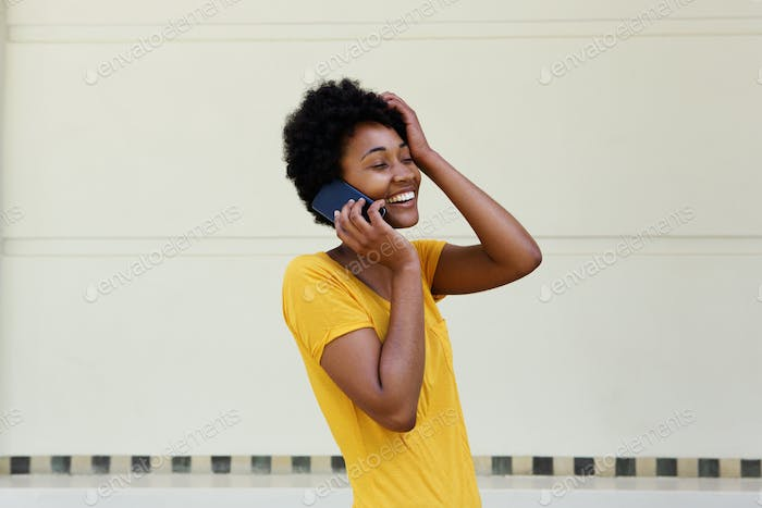Young woman talking on mobile phone and smiling