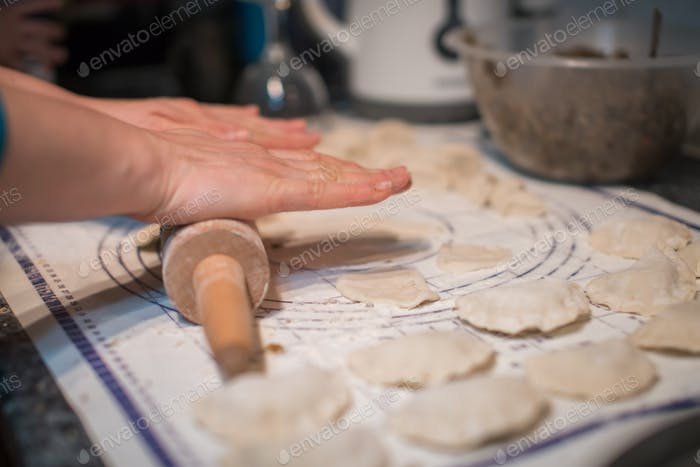 Woman preparing pierogi in the kitchen