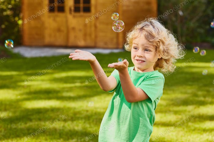 Son playing with soap bubbles