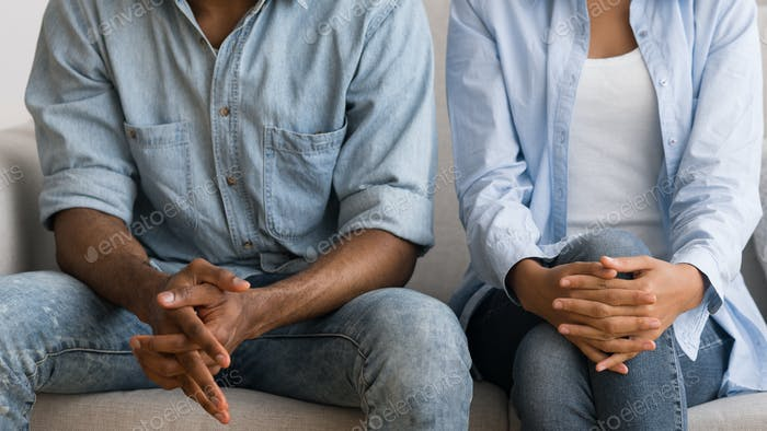 Unrecognizable Afro Couple Sitting On Couch At Marital Counselor's Office