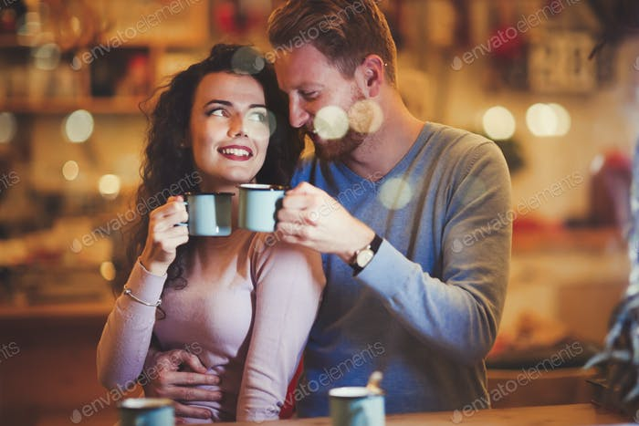 Couple dating in restaurant at xmas