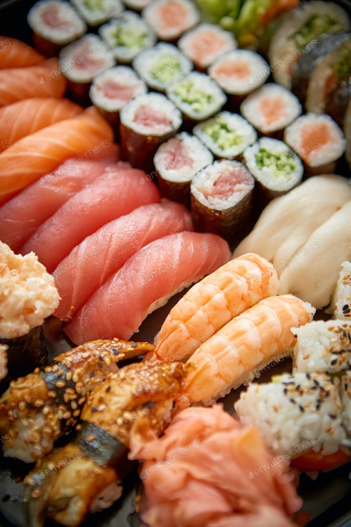 Close up of various types of japanese fresh prepared sushi.