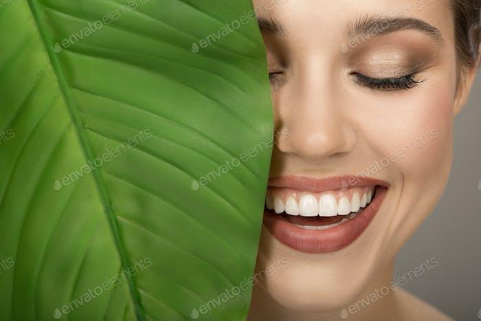 Portrait Of Woman And Green Leaf. Organic Beauty.
