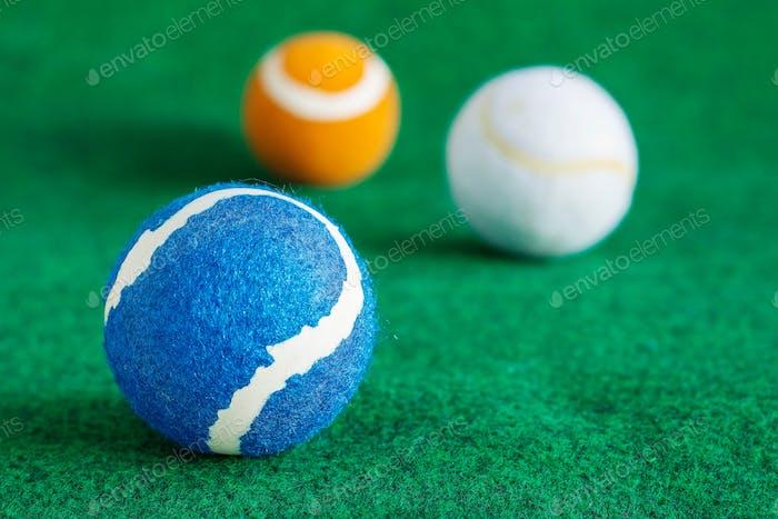 tennis balls on lawn