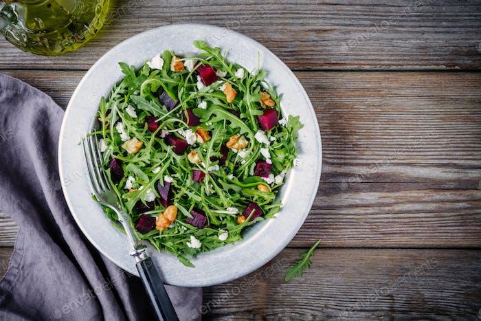 Fresh green salad with arugula, beets, walnuts and feta cheese