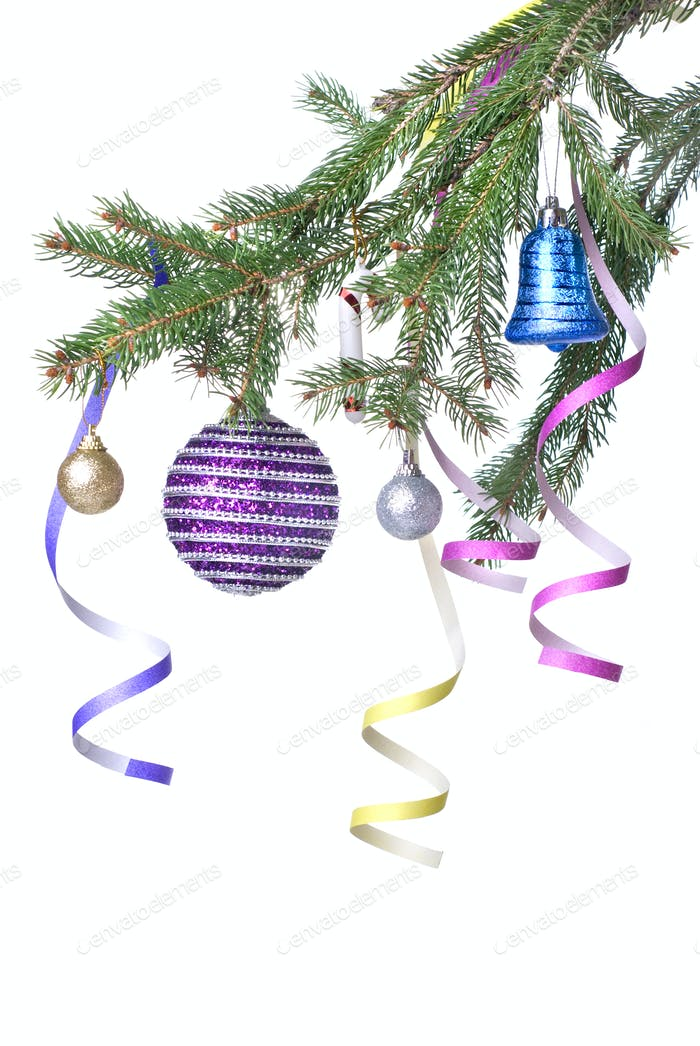Christmas balls and decoration on fir tree branch isolated on wh