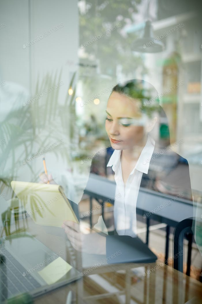 Female entrepreneur correcting document