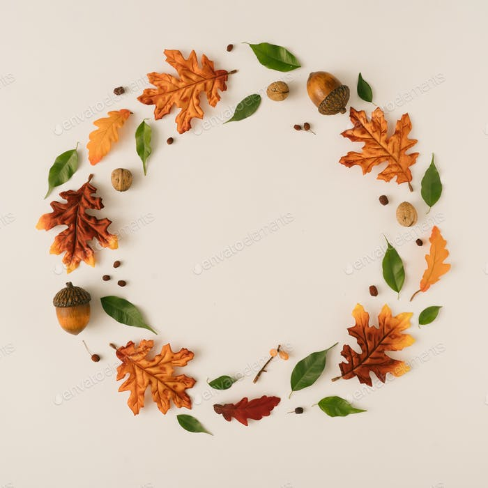 Creative season layout of colorful autumn leaves and branches.