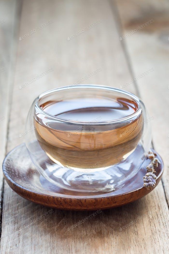 Herbal lavender tea in oriental glass cup, vertical, copy space