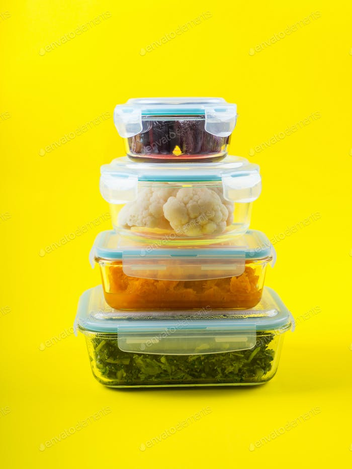 Stack of airtight glass containers with cooked food